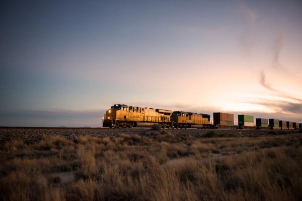 A railroad locomotive at dusk.