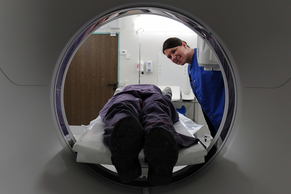 A photo of a neuropsychologist with her patient in an MRI machine.