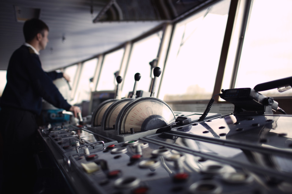 A photo of a yacht crew member aboard the bridge.