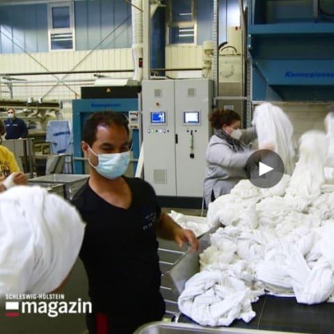 Nach monatelangem Stillstand: Wäscherei läuft wieder auf Hochtouren