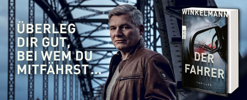 Banner mit Andreas Winkelmann und «Der Fahrer»