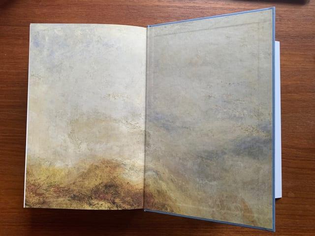 Das Frontispiz eines aufgeklappten Buches, das ein Gemälde von William Turner zeigt
