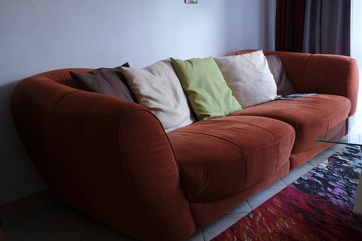 Brown Sofa with Solid Color Throw-Pillows