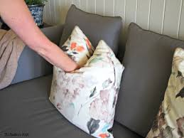 image shows how to chop a throw pillow when decorating a home using throw pillows