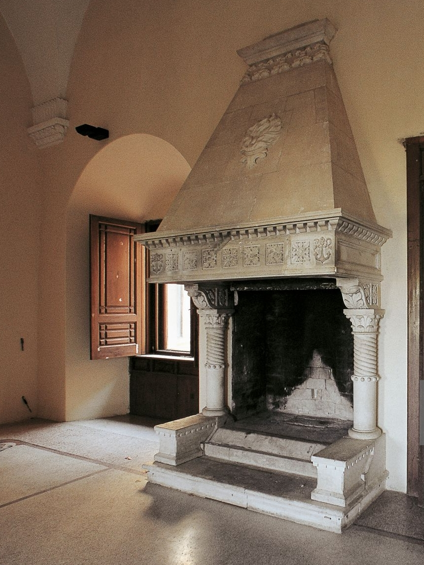 Sometime around the medieval period a chimney extension called a mantel was built like a funnel over the fireplaces to help to catch the smoke, see image below.