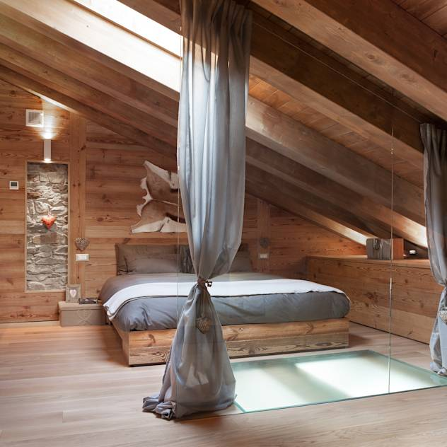 UN CALDO CHALET DI DESIGN : Camera da letto % in stile % {style} di {professional_name}