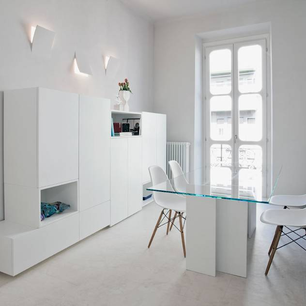 HOUSE FOR HOLIDAYS : Sala da pranzo minimalista di PAOLO FRELLO & PARTNERS