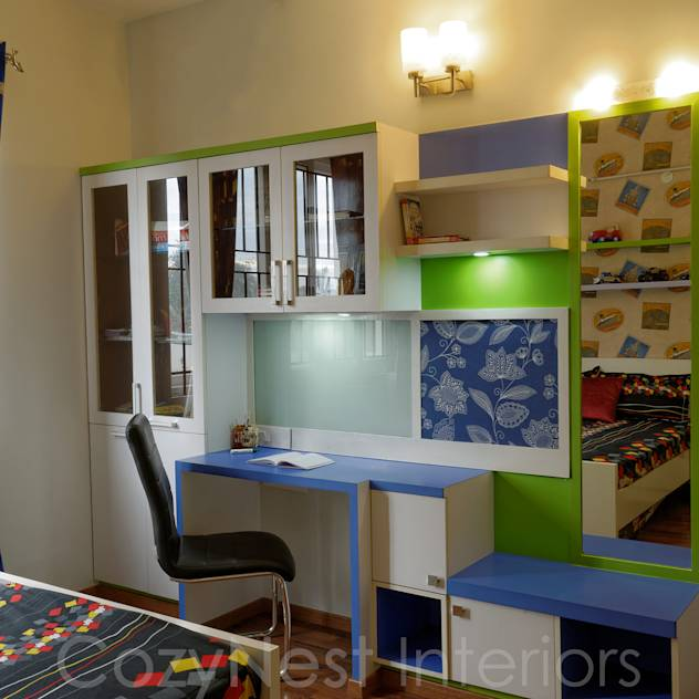 Priyanka & Yashbir: Modern Nursery/kid's room by Cozy Nest Interiors