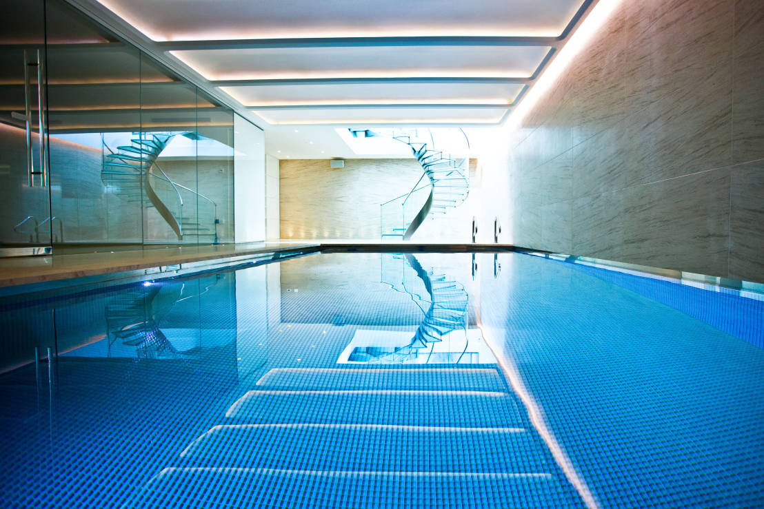 An elegant basement pool north london Basement swimming pool construction