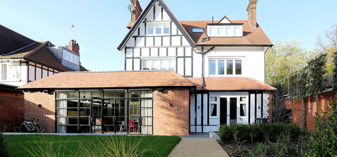 Period meets modern tudor home transformation for Modern tudor house