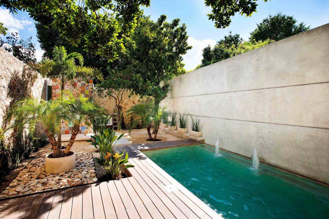 20 casas com piscinas de outro mundo for Fotos de piscinas en patios pequenos