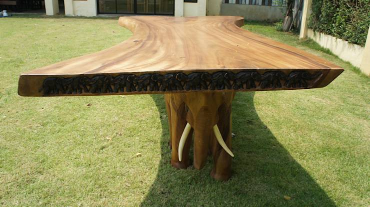 Six exclusive dining table designs full of surprise for Exclusive dining table designs