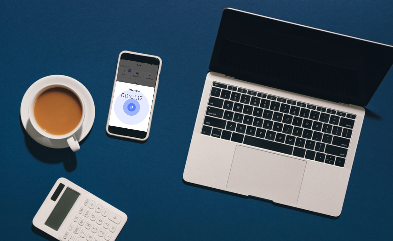Table showing best time tracking app next to coffee cup and laptop