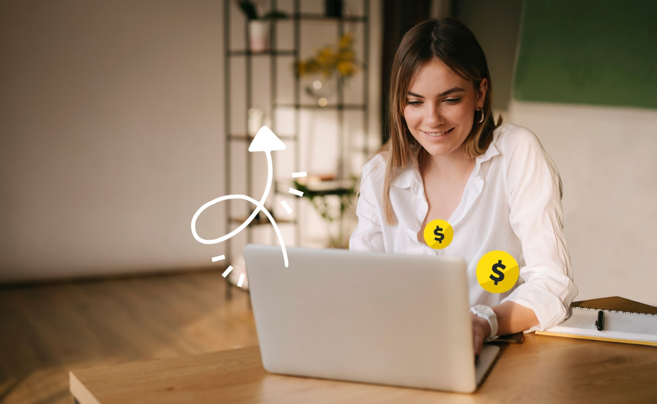 Woman sits behind a laptop looking at a screen. Dollar symbols and an arrow graphic symbolize higher conversions