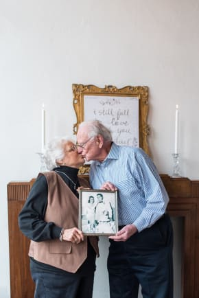 Couple kisses at their 65th anniversary photoshoot