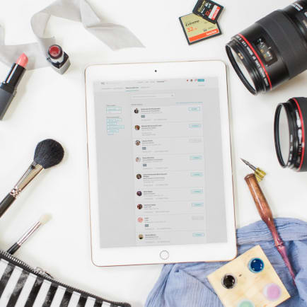 Flat lay of a creative entrepreneur's desk with the HoneyBook and Rising Tide Creative Community on an iPad