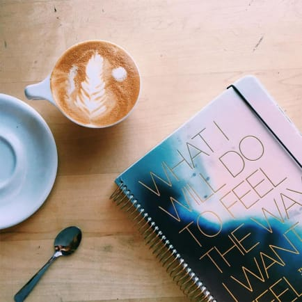 Flat Lay of a Coffee and a Planner for creatives