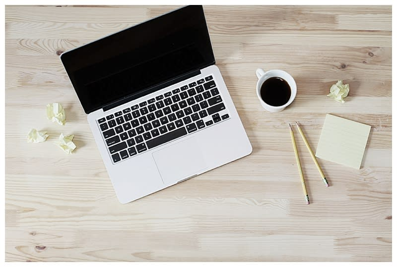 Flat lay of computer and coffee on a desk by Lauren Mancke on the Rising Tide Society & HoneyBook blog