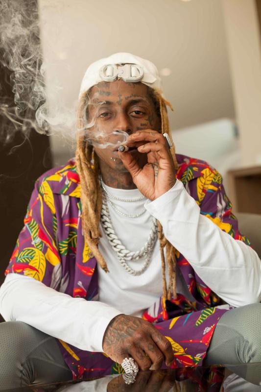 I'm a Business, Man: Lil Wayne Lights Up His Own Lane
