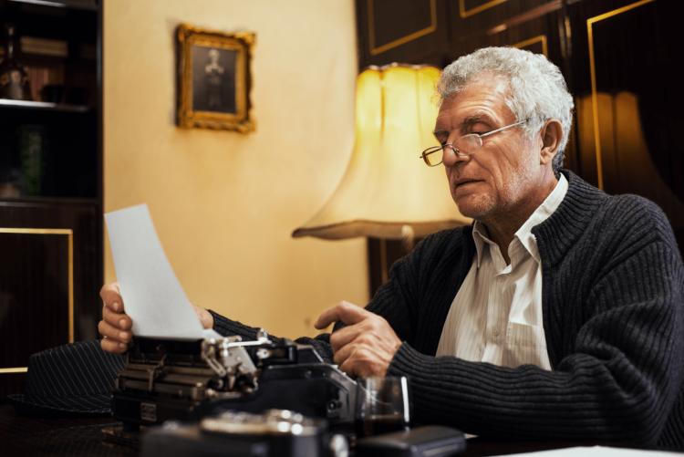 old_man_typewriter-min_o473lj