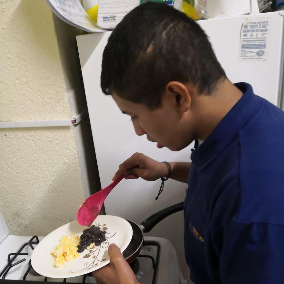 Diego serving food