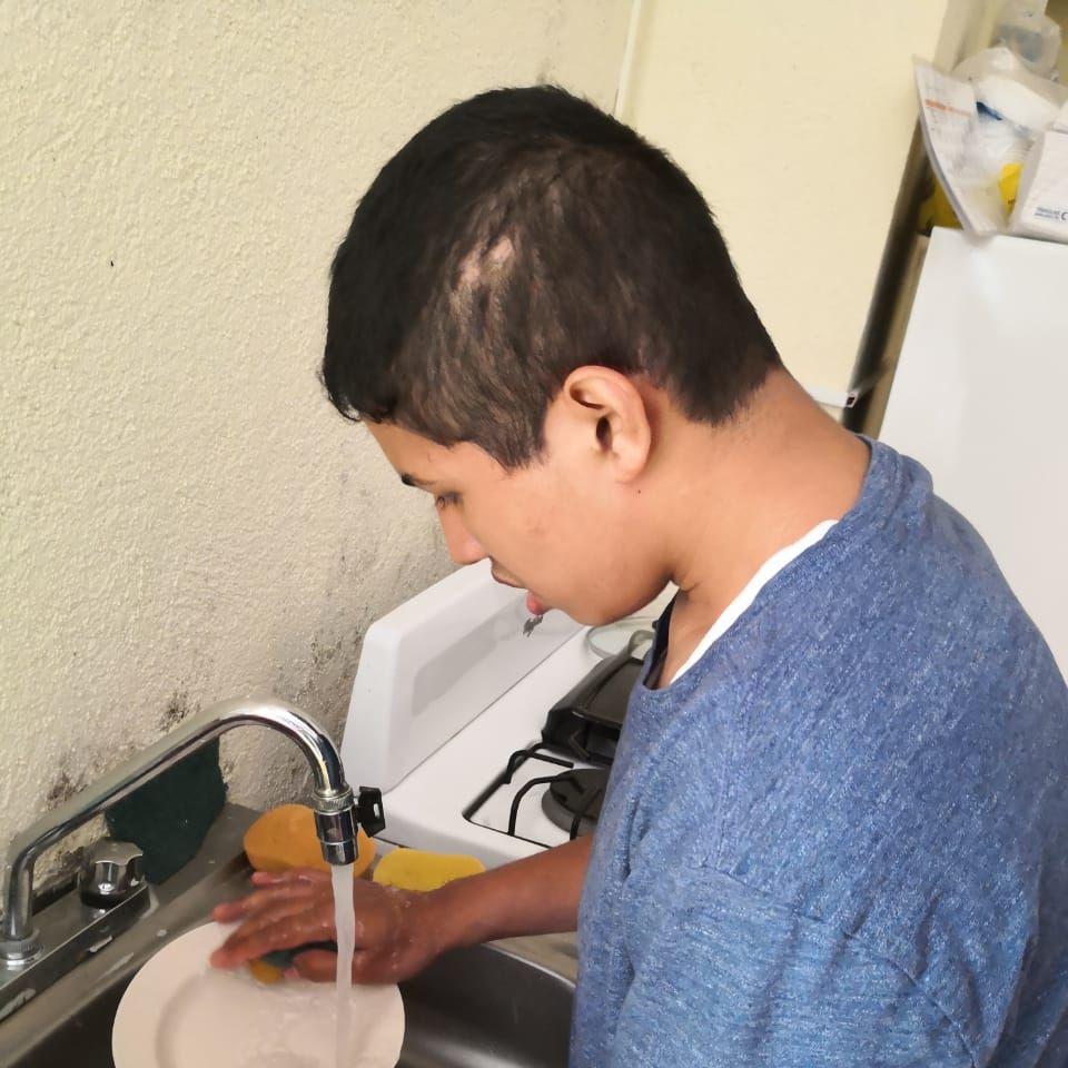 Diego washing dishes