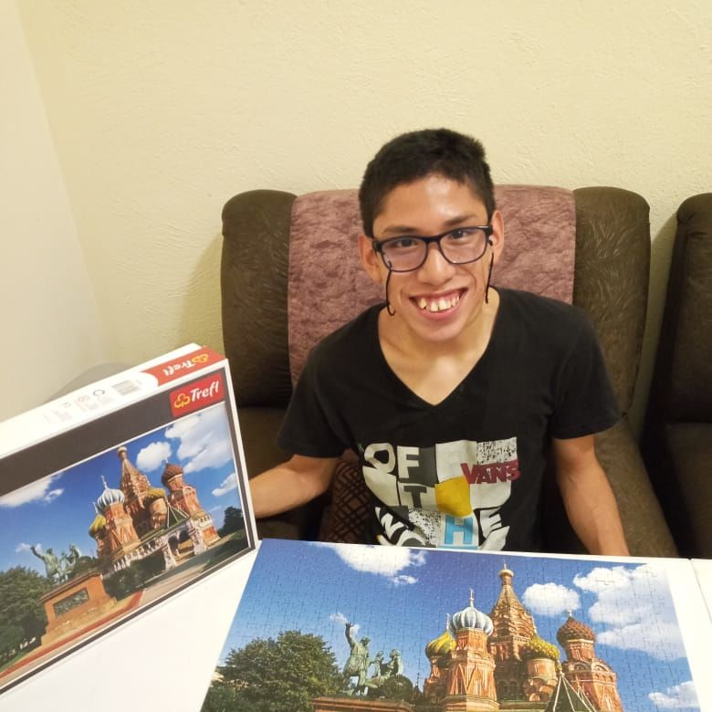 Carlos with a finished puzzle