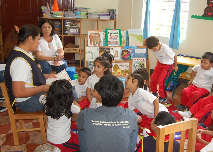 picture of teacher reading to children