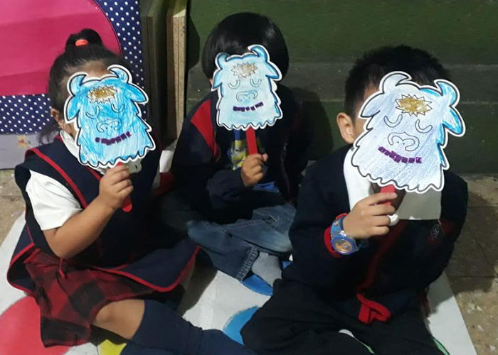 children interacting with lesson activity