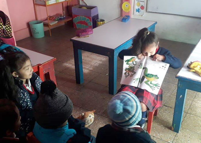 child reading to class