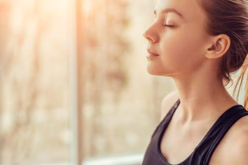 emotional intelligence routines woman meditating breathing exercises