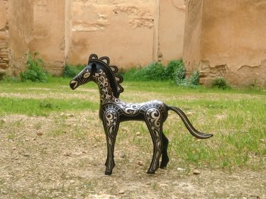 Black, White Steel and Silver Animal