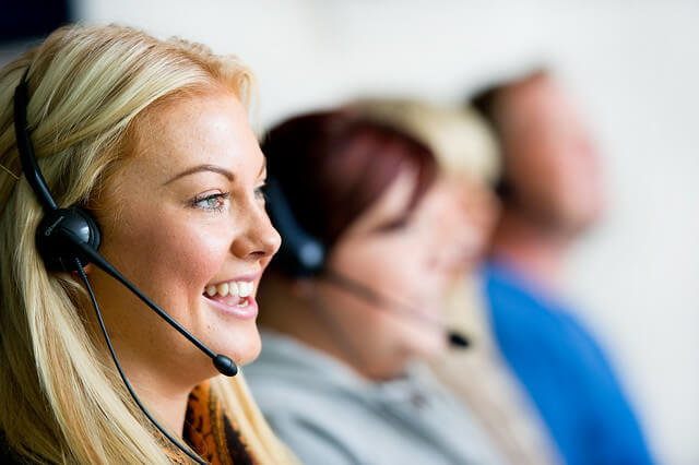 A close-up of a customer support agent on the phone.