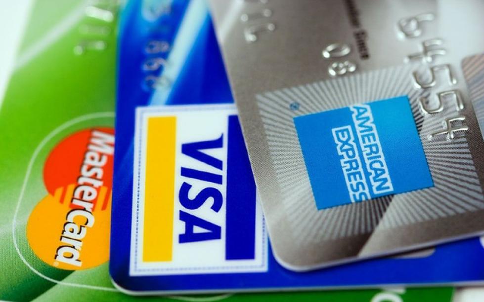 Three credit cards from Visa, Mastercard, and AMEX