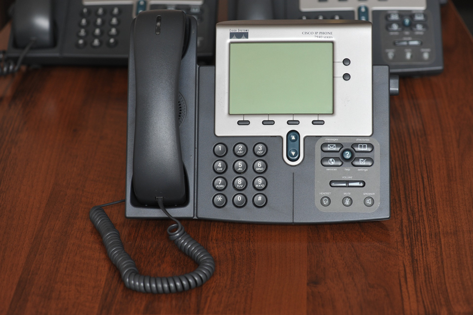 Cisco Work Phone on a Mahogany Desk