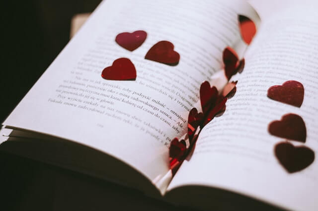 A book with love hearts cut-outs.