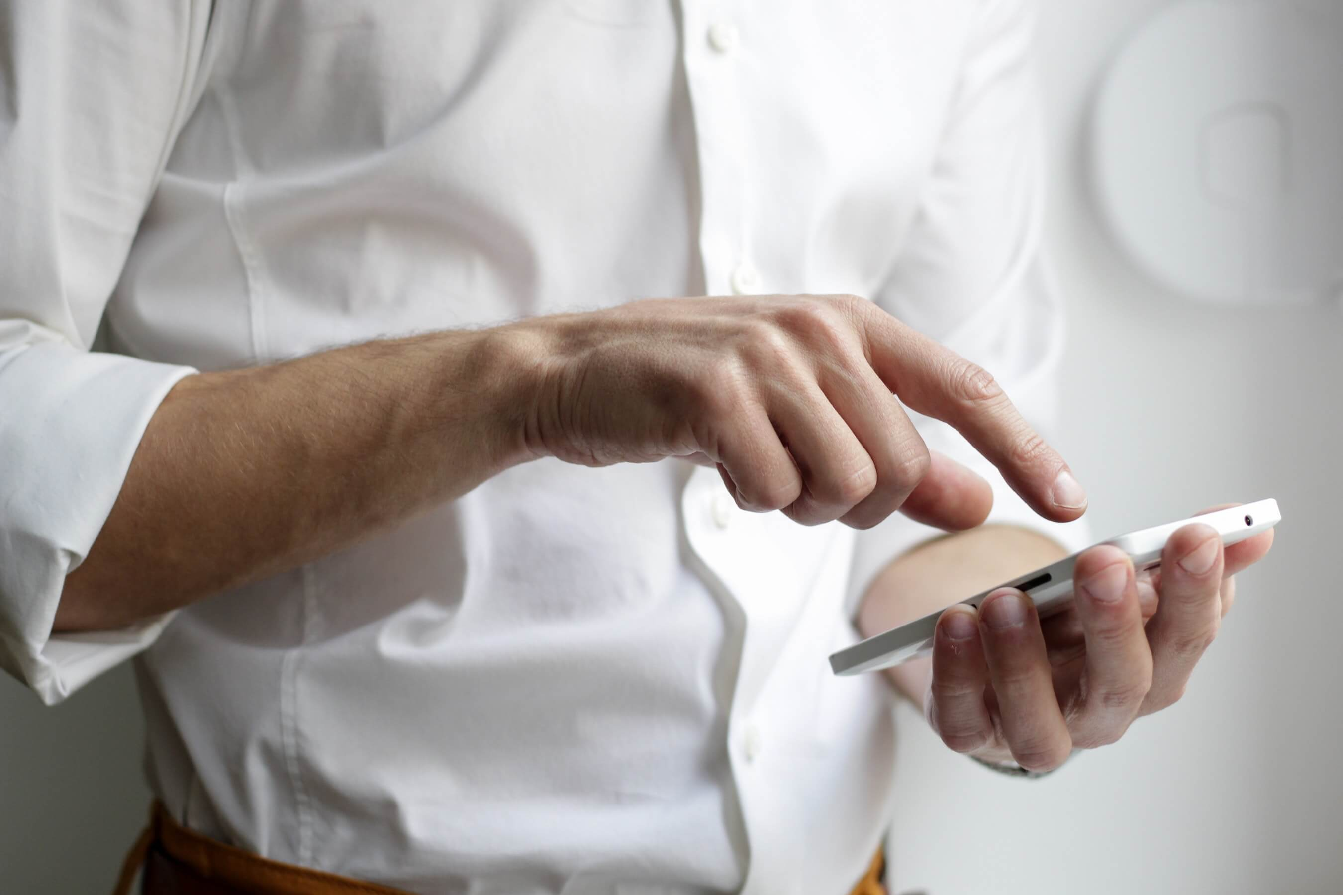 man using his phone to contact a business