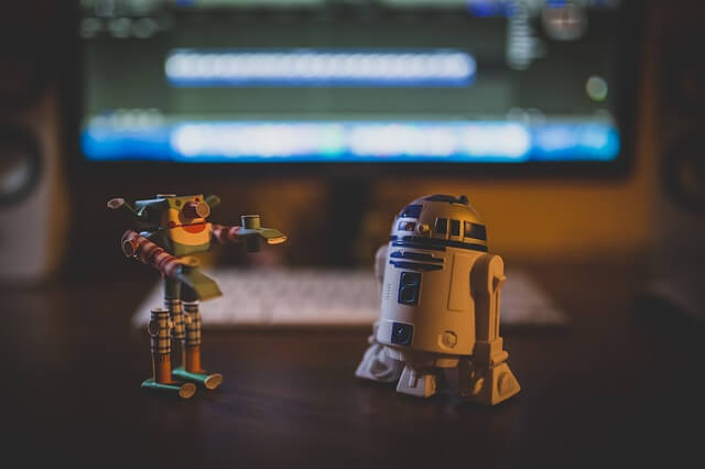 Two robot toys on desk.