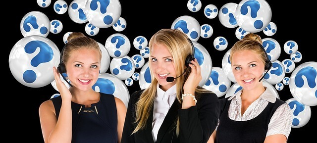 A line of customer support agents with question mark graphics behind them.