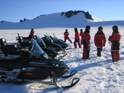 Hostel guests on snowmobile Iceland