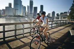 Cyclists riding along the Brisbane River