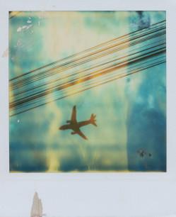 plane sky polaroid