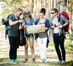 Four backpackers in the woods