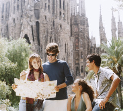 Group of friends looking on the map in Barcelona