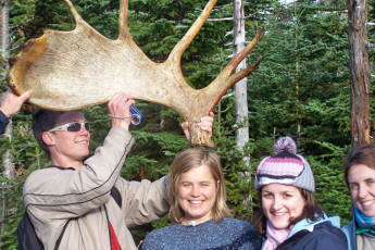 HI - Cape Breton : Hostel guests holding a Canadian moose's antler