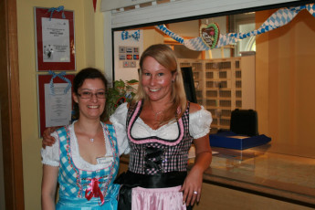 München - City : staff in traditional Bavarian Lager clothing at the reception of Munich City Hostel