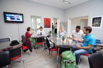 Koln - Pathpoint Cologne : Guests socialising in common room with TV at Koln Pathpoint Cologne