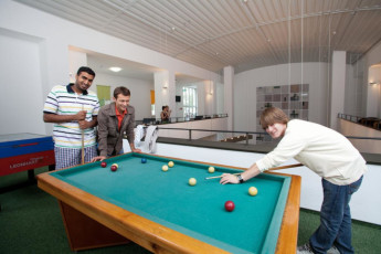Koln - Pathpoint Cologne : Guests playing pool in common room at Koln Pathpoint Cologne