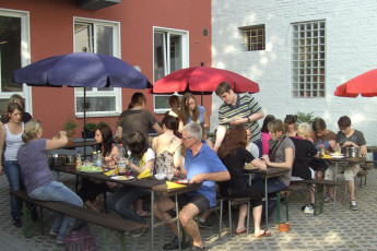 Koln - Pathpoint Cologne : People eating on the terrace at Koln Pathpoint Cologne