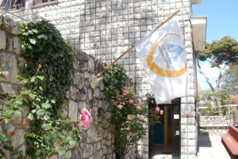 Dubrovnik : HI flag hanging outside the front entrance of Youth Hostel Dubrovnik